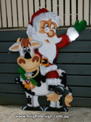Santa on Christmas Cow Outdoor Christmas Display for home and commercial Christmas Decorating Handmade by Bright Design Airbrushing Studio