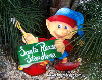 4- E-13 CG Santa Stop Here Paintng Elf Outdoor Christmas Cut Out in a Home Garden Christmas Display