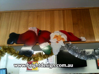 2- S-02 cg Lazy Santa Sleeping on Commercial Shop Counter - Outdoor displays no limited to the outdoors