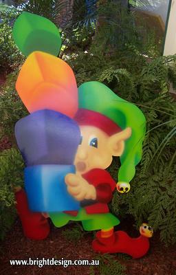 4- E-33 Unbalanced Christmas Presents Elf Outdoor Christmas Cut Out in a Garden Christmas Display