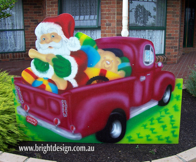 Santa and Christmas Presents in Australian Ute Outdoor Christmas Display for home and commercial Christmas Decorating Handmade by Bright Design Airbrushing Studio